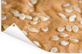 Close up van een broodje met de sesamzaadjes Tuinposter 180x120 cm - Tuindoek / Buitencanvas / Schilderijen voor buiten (tuin decoratie) XXL / Groot formaat!