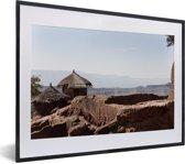 Foto in lijst - Uitzicht over de heilige stad Lalibela in Ethiopië fotolijst zwart met witte passe-partout klein 40x30 cm - Poster in lijst (Wanddecoratie woonkamer / slaapkamer)