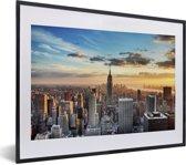Foto in lijst - Indrukwekkende lucht boven het Empire State Building in Amerika fotolijst zwart met witte passe-partout klein 40x30 cm - Poster in lijst (Wanddecoratie woonkamer / slaapkamer)