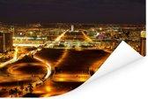 De verlichtte stad Brasilia tijdens de avond in Brazilië Poster 180x120 cm - Foto print op Poster (wanddecoratie woonkamer / slaapkamer) XXL / Groot formaat!
