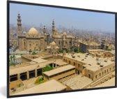 Foto in lijst - Felle zon schijnt over de gebouwen in de Egyptische stad Caïro fotolijst zwart 60x40 cm - Poster in lijst (Wanddecoratie woonkamer / slaapkamer)