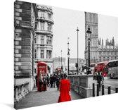 Zwart-wit foto van een vrouw in een rode jurk Canvas 180x120 cm - Foto print op Canvas schilderij (Wanddecoratie woonkamer / slaapkamer) XXL / Groot formaat!
