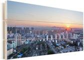 Zonsondergang in de Chinese stad Fuzhou Vurenhout met planken 80x40 cm - Foto print op Hout (Wanddecoratie)