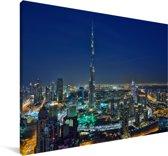Dubai en de Burj Khalifa verlicht in de avond Canvas 90x60 cm - Foto print op Canvas schilderij (Wanddecoratie woonkamer / slaapkamer)