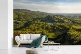 Fotobehang vinyl - Een uitzicht over het nationaal park Snowdonia in Wales breedte 450 cm x hoogte 300 cm - Foto print op behang (in 7 formaten beschikbaar)