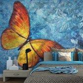 Fotobehang - Vlinder in het oranje geel , blauw