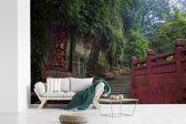 Fotobehang vinyl - Pad naar de Grote Boeddha van Leshan breedte 540 cm x hoogte 360 cm - Foto print op behang (in 7 formaten beschikbaar)