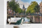 Fotobehang vinyl - Brug over de Prinsengracht in Amsterdam breedte 450 cm x hoogte 300 cm - Foto print op behang (in 7 formaten beschikbaar)