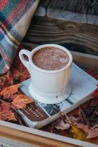 A Cozy Autumn Still Life with a Hot Drink, Leaves, and a Book Journal