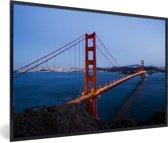 Foto in lijst - Golden Gate Bridge verlicht in de avond fotolijst zwart 60x40 cm - Poster in lijst (Wanddecoratie woonkamer / slaapkamer)