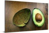 Verse avocado in tweeën gesneden Aluminium 180x120 cm - Foto print op Aluminium (metaal wanddecoratie) XXL / Groot formaat!