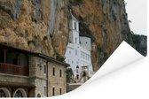 Het Ostrogklooster van de Servisch-orthodxe Kerk in Montenegro Poster 180x120 cm - Foto print op Poster (wanddecoratie woonkamer / slaapkamer) XXL / Groot formaat!