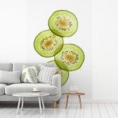 Fotobehang vinyl - Stapeltje kiwi plakken met doorschijnend licht breedte 270 cm x hoogte 400 cm - Foto print op behang (in 7 formaten beschikbaar)
