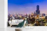 Fotobehang vinyl - Het Taiwanese Kaohsiung in Azië tijdens de nacht breedte 540 cm x hoogte 360 cm - Foto print op behang (in 7 formaten beschikbaar)