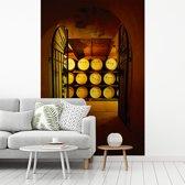Fotobehang vinyl - Afbeelding van de ingang van een wijnkelder breedte 200 cm x hoogte 300 cm - Foto print op behang (in 7 formaten beschikbaar)