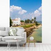 Fotobehang vinyl - Het Sri Lankaanse Fort Galle met de zee op de voorgrond breedte 220 cm x hoogte 300 cm - Foto print op behang (in 7 formaten beschikbaar)