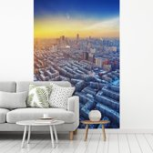 Fotobehang vinyl - Vlammende lucht boven de Chinese stad Shenyang breedte 215 cm x hoogte 320 cm - Foto print op behang (in 7 formaten beschikbaar)