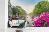 Fotobehang vinyl - Kleurrijke foto van de Prinsengracht van Amsterdam breedte 450 cm x hoogte 300 cm - Foto print op behang (in 7 formaten beschikbaar)