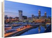 Skyline van Cleveland in de Verenigde Staten tijdens de avond Vurenhout met planken 80x40 cm - Foto print op Hout (Wanddecoratie)