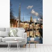 Fotobehang vinyl - De grachten van de Nederlandse stad Groningen breedte 205 cm x hoogte 270 cm - Foto print op behang (in 7 formaten beschikbaar)
