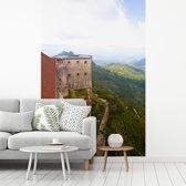 Fotobehang vinyl - Uitzicht over het Citadelle Laferrière en het mooie groene gebergte breedte 215 cm x hoogte 320 cm - Foto print op behang (in 7 formaten beschikbaar)