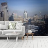 Fotobehang vinyl - Het grijze centrum van Anshan in China breedte 375 cm x hoogte 280 cm - Foto print op behang (in 7 formaten beschikbaar)
