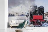 Fotobehang vinyl - Afbeelding van een gekleurde stoomlocomotief breedte 450 cm x hoogte 300 cm - Foto print op behang (in 7 formaten beschikbaar)
