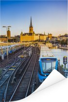 Uitzicht op een spoorweg Poster 60x90 cm - Foto print op Poster (wanddecoratie woonkamer / slaapkamer)