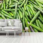 Fotobehang vinyl - Opgestapelde komkommers breedte 535 cm x hoogte 400 cm - Foto print op behang (in 7 formaten beschikbaar)