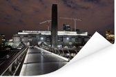 De Tate Modern en de Millenium Bridge verlicht in de avond Poster 180x120 cm - Foto print op Poster (wanddecoratie woonkamer / slaapkamer) / Europese steden Poster XXL / Groot formaat!