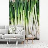 Fotobehang vinyl - Langwerpige sint-jansuien opgestapeld in een krat breedte 375 cm x hoogte 500 cm - Foto print op behang (in 7 formaten beschikbaar)