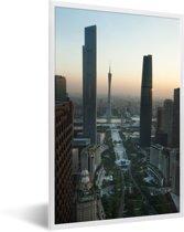 Foto in lijst - Zonnestralen over Guangzhou fotolijst wit 40x60 cm - Poster in lijst (Wanddecoratie woonkamer / slaapkamer)