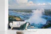 Fotobehang vinyl - Luchtfoto van de Niagarawatervallen breedte 420 cm x hoogte 280 cm - Foto print op behang (in 7 formaten beschikbaar)