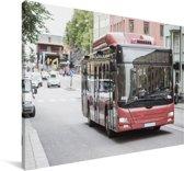 Een vooraanzicht van een rood gekleurde bus Canvas 120x80 cm - Foto print op Canvas schilderij (Wanddecoratie woonkamer / slaapkamer)