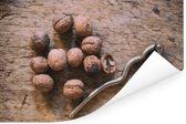 Bruine walnoten op oude houten tafel met notenkraker Poster 30x20 cm - klein - Foto print op Poster (wanddecoratie woonkamer / slaapkamer)