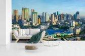 Fotobehang vinyl - Skyline van Manila in de Filipijnen breedte 430 cm x hoogte 240 cm - Foto print op behang (in 7 formaten beschikbaar)