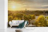 Fotobehang vinyl - Zonsondergang over Montpellier in Frankrijk breedte 600 cm x hoogte 400 cm - Foto print op behang (in 7 formaten beschikbaar)