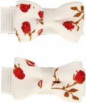 Setje van twee rode baby haarspeldjes wit met roosjes