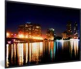 Foto in lijst - Verlichting van de gebouwen in Caïro in de nacht fotolijst zwart 60x40 cm - Poster in lijst (Wanddecoratie woonkamer / slaapkamer)