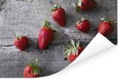 Aardbeien op donkere houten tafel Poster 180x120 cm - Foto print op Poster (wanddecoratie woonkamer / slaapkamer) XXL / Groot formaat!