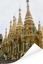 Een rij van kleine stoepa's bij Shwedagon-Pagode in Myanmar Poster 40x60 cm - Foto print op Poster (wanddecoratie woonkamer / slaapkamer)
