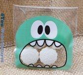 50x Transparante Uitdeelzakjes Monster Design Groen 10 x 10 cm met plakstrip - Cellofaan Plastic Traktatie Kado Zakjes - Snoepzakjes - Koekzakjes - Koekje - Cookie Bags Monster
