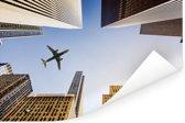 Prachtig vliegtuig tussen de wolkenkrabbers Poster 120x80 cm - Foto print op Poster (wanddecoratie woonkamer / slaapkamer)