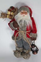 Staande kerstman met zak en lantaarn en stoffen kleding - 30 cm