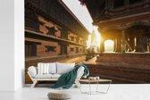 Fotobehang vinyl - Zonsondergang op het Durbarplein in Nepal breedte 390 cm x hoogte 260 cm - Foto print op behang (in 7 formaten beschikbaar)