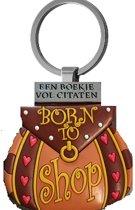 Een boekje vol citaten Born to Shop aan een sleutel hanger