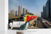 Fotobehang vinyl - Gekleurde trein in het Chinese Chongqing breedte 330 cm x hoogte 220 cm - Foto print op behang (in 7 formaten beschikbaar)