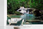 Fotobehang vinyl - Een waterval bij het Thaise Nationaal park Erawan breedte 450 cm x hoogte 300 cm - Foto print op behang (in 7 formaten beschikbaar)