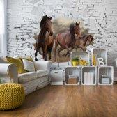 Fotobehang 3D Horses Jumping Through Hole In Brick Wall | VEXXL - 312cm x 219cm | 130gr/m2 Vlies