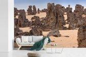 Fotobehang vinyl - Stenen in het Nationaal park Tassil n'Ajjer breedte 600 cm x hoogte 400 cm - Foto print op behang (in 7 formaten beschikbaar)